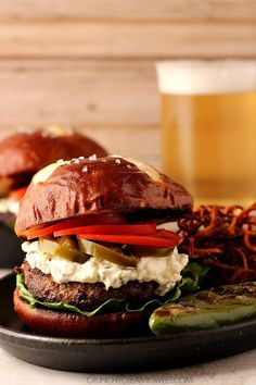 Jalapeno Popper Burger - beef burger grilled to perfection and topped with jalapeno popper filling. Spicy, juicy and perfect game day food!