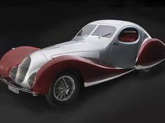 Another creation of Figoni and Falaschi, the Talbot-Lago T-150C was a popular racing car nicknamed Goutte d'Eau (drop of water) by the French, and Teardrop Talbot by the English. Its unique aerodynamic contour mimics one of nature's most aerodynamic shapes: the water droplet, or teardrop, a popular Art Deco motif. The two builders spent 2100 hours handcrafting each body. Because they were hand-built, each Teardrop coupe is unique. The Talbot features a four-liter, six-cylinder engine…