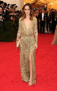 Leighton Meester went for the gold in Emilio Pucci's embroidered tulle long-sleeve gown. #MetGala