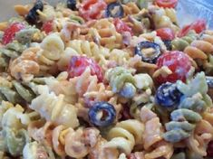 Ingredients:  1 (12 ounce) packageuncooked tri-colored rotini pasta  10 slices bacon  1 cup mayonnaise  1 (1 ounce) packet dry ranch dressing mix  1⁄4 teaspoon garlic powder  1⁄2 cup milk (more, if needed)  1 large tomatoes, chopped or 15 grape tomatoes, cut in
