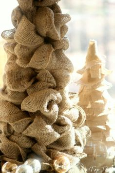 DIY Burlap Trees for the Season.  Christmas cone trees can be decorated in so many ways