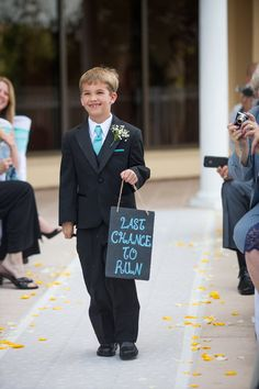 Ringbearer sign says it all! Photo By Ashley Posusta Photography. LOL.. now this is funny!
