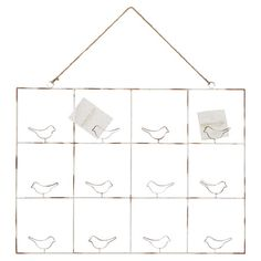 Distressed Iron hanging card and photo holder with bird silhouettes.   Product: Card and photo holderConstruction Ma...