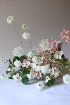 Soft millennial pink and white spring/winter arrangement centerpiece
