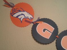 """GO Denver BRONCOSBanner Superbowl XLVIII by AllLayedOut on Etsy, $18.00 Show your Team Spirit!! Add this Orange and Blue DENVER BRONCOS BANNER to your SuperBowl XLVIII party.  Measures 59"""" long each Circle card is 5.1"""" around  This Item will ship out USPS First Class.. if you want it or need it faster before Feb.2nd send me a convo and I will create a Rush order with USPS Priority Shipping costs  Created in a Smoke Free Home Questions please ask!!  GO BRONCOS!!!!"""