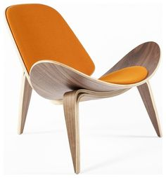 """[Stilnovo Bent Playwood Bishop Chair] I love the extreme swoop of the form, & the citrus orange upholstery on the seat & backrest! """"Bent plywood employed in three legs and a seat with wings are distinctive design features of this Bishop chair inspired by a Hans Wegner design. The walnut wood veneer is finished in a rich medium walnut tone"""""""