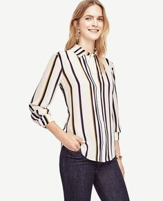 """Crafted from pure silk, this wardrobe essential defines refined. Point collar. Long sleeves with shirred cuffs and button closure. Button front. Shirred back yoke. Shirttail hem. 26 1/4"""" long."""