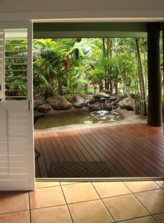 The deluxe king spa rooms at the Eco Village Mission Beach go above and beyond to create a secluded rainforest environment — within the secluded rainforest environment of North Australia's Mission Beach.| Green Bride Guide