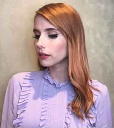 Ready to try the hair trend that's taking over Instagram? Rose gold hair is a pretty, ethereal shade of pink-tinted blonde that's being worn by celebs like Emma Roberts. It's so radiant, it lights up your whole look — even if you're not wearing any makeup!