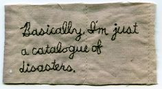 """""""Basically, I'm just a catalogue of disasters."""" 2012. Embroidery on fabric dyed with onion skin. Borrowed text. 2″ x 3.75″ by Iviva Olenick"""