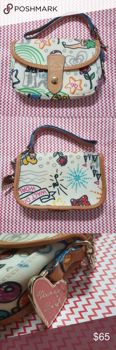 Dooney & Bourke   Walt Disney Wristlet Brand: Dooney & Bourke Size: 6 1/4 in L, 4in H Color: Multi Style: Walt Disney World NWOT! Buyers can expect: Careful packaging, Fast shipping, & Delivery confirmation with each item purchased! PET FREE HOME & SMOKE-FREE HOME. Please note: Due to lighting and monitors, the items colours may be slightly differ with the picture. Dooney & Bourke Bags Clutches & Wristlets