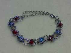 I made this with jump rings & beads