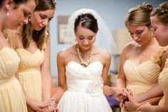 praying with the girls before the ceremony