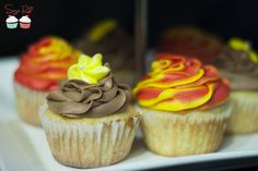 Fireball Whiskey Cupcakes & Yellow Cupcakes with Raspberry Filling and Chocolate Frosting. Hand piped royal icing flowers