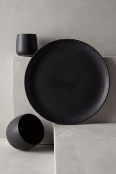 Anthro's Latest Home Collaboration Is A Seaside Dream   #refinery29  http://www.refinery29.com/2014/07/71869/lost-and-found-anthropologie-home#slide8  Dark, matte dishware is earthy and elegant.