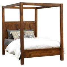 Rustic in design and details, this mango wood canopy bed makes a stately anchor for your guest room or master suite.  Product: C...