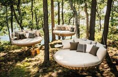 """Cool idea.  Repurpose old trampolines into outdoor """"grown up"""" swings . . ."""