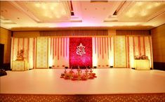 Now in Chennai. Elegance at its best. For Events & weddings. Wedding décor plays a massive role in this occasion where we decide many… Indian Wedding Stage, Wedding Backdrop Design, Desi Wedding Decor, Wedding Hall Decorations, Wedding Reception Backdrop, Wedding Mandap, Backdrop Decorations, Background Decoration, Wedding Backdrops