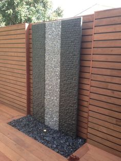 Standing tall, this water feature uses the contrasting colours of the natural solid granite panels to create a water feature that is a focal point of this garden. Small Water Features, Outdoor Water Features, Water Features In The Garden, Garden Features, Outdoor Wall Fountains, Diy Garden Fountains, Water Wall Fountain, Outdoor Waterfalls, Entry Wall
