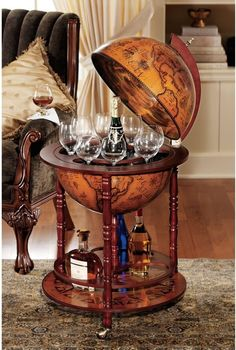 The Design Toscano Sixteenth-Century Italian Replica Globe Bar is a charming globe on a stand. The globe opens, and the compartment inside can hold bottles, glasses, even some decanters. {ad} http://amzn.to/2goEMbK