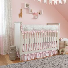 French Gray and Pink Damask Crib Bedding | Carousel Designs.  Sweet yet elegant and classic, this stunning crib bedding collection would fit perfectly into your little girl's nursery. The soft shade of French Gray coupled with a timeless pastel pink makes this bedding irresistible. We have added the adorable pink triple tier ruffle skirt to this collection along plush white minky for the finishing touch.