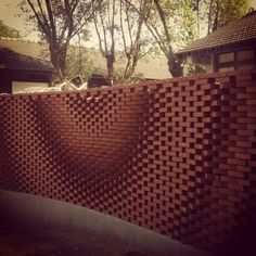 Brick wall by Gramazio Kohler Their research focuses on additive digital fabrication techniques, described as a three-dimensional printing process by positioning material precisely to interweave. Brick Design, Facade Design, Wall Design, Parametric Architecture, Brick Architecture, Parametric Design, Brick Fence, Brick Facade, Landscape Stairs
