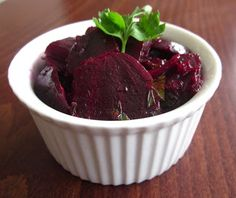 *BEET SALAD*  Start with 6 organic beets; Wash beetsthoroughly and chop off the ends; Wrap in foil and bake in an aproximately200 Celsius (400Fahrenheit)oven  until soft (1 1/2 to 2 hours);   Tip: Put them in the oven when you're baking something else; Peel.; Slice or grate; Add 2 cloves crushed garlic; Add chopped parsley; Add a simple olive oil and vinegar vinaigrette and salt to taste; Serve chilled; Enjoy your delicious beet salad!