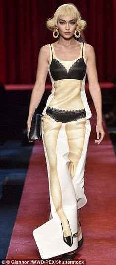 All dolled up: Known for his kooky style, Moschino creative director Jeremy Scott had firs...