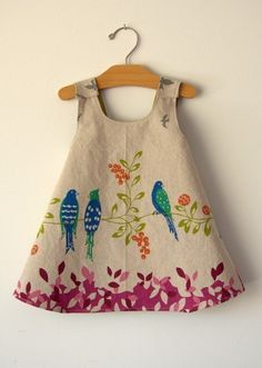 Birdsong Reversible Modern Pinafore Dress by noahandlilah. They are no longer in business. However, it is a simple back cross pinafore easy to make. Lovely over a dress with puff sleeves.