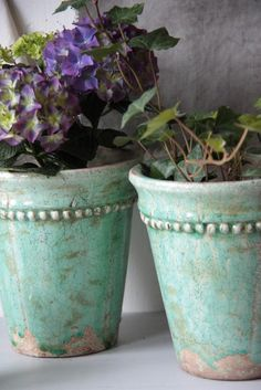 I'm thinking you could glue fake pearls around pots and paint with chalk paint..how sweet