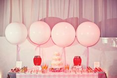 Love the extra large balloons tied on ribbon.