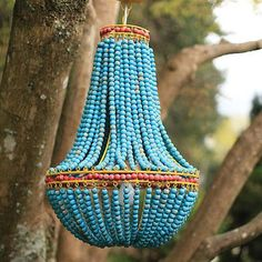 Colorful wooden beads transform a typical pendant lamp into something extraordinary.
