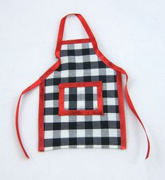 Black and white check apron with red trim.