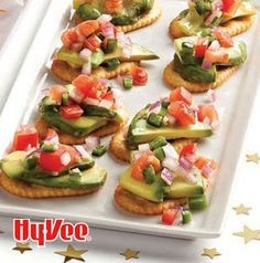 Think of Avocado Cracker Bites as deconstructed guacamole. Simple top a cracker with slices of ripe avocado and a dollop of pico. Couldn't be simpler.
