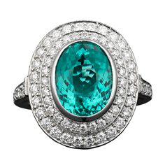 A fantastic 3.71-carat Paraiba tourmaline is featured in this exquisite Tiffany & Co. platinum ring.... I love the color of this blue stone...