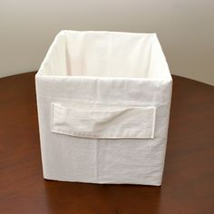 Pillowcase box tutorial. Made out of a pillowcase and cardboard. So clever!