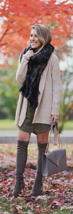 Stephanie Sterjovski wears a pair of over the knee boots with a khaki shirt dress and cute knitted cardigan.