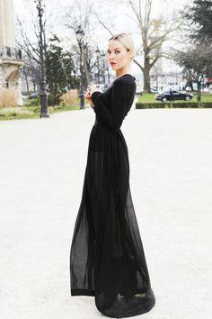 Ulyana in Paris wearing Ulyana Sergeenko dress