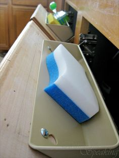 How to change the false fronts under the sink to a tilt-out little storage space!  I actually had my handyman do it, it is a nice storage bonus.
