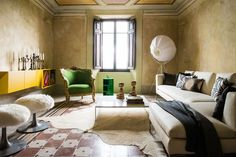 Atmosphere (and a good dose of quirk) abounds in the living room of Mazzini 31   Lonny.com
