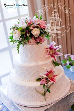 Fresh flowers adorn this buttercream wedding cake with hand-piped swirls.