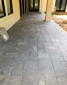 "Gray slate on the porches - The stucco is not the right color yet, it's going to be SW Alabaster, much whiter. I love the steel gray slate in a Versailles or ""Roman"" pattern that we did from Thorntree Slate in Houston."
