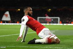 Alexandre Lacazette of Arsenal celebrates after scoring his sides first goal during the UEFA Europa League Semi Final leg one match between Arsenal FC and Atletico Madrid at Emirates Stadium on April 2018 in London, United Kingdom. Arsenal Fc, Madrid, Soccer Stuff, London United, April 26, Semi Final, Europa League, First Photo, Finals