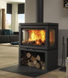 Dik Geurts Vidar Triple 3 sided Modern Log Store stove & more stoves at The Stove House, your local stove supplier with over experience Wood Burner Fireplace, Modern Fireplace, Living Room With Fireplace, Fireplace Design, Wood Burning Fireplaces, Wood Stove Decor, Wood Stove Hearth, Fireplace Ideas, Contemporary Wood Burning Stoves