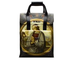 Our small leather backpack is built to last, with heavy-duty buckle fastenings, a double carry handle and exterior pocket for all the things you need to get at quickly. The Di Paolo print is limited edition emblazoned with The Annunciation, a painting by Giannicola Di Paolo-which features the archangel Gabriel handing a lily, the symbol of purity, to the Virgin Mary. Religion, meets counterculture. Selections from Di Paolo's designs are digitally printed onto our backhand leather. Classic…