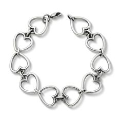 A graceful symbol of love and affection, two hearts are joined to form the links of our sterling silver Open Heart Link Bracelet. #JamesAvery