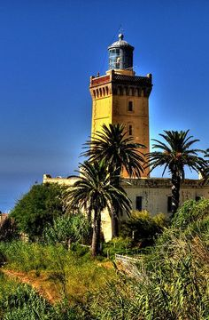 Cap Spartel lighthouse is above the Caves of Hercules, near the northernmost point of Morocco, approximately 15 km west of the Port of Tangier. It is here that the Mediterranean Sea meets the Atlantic Ocean.  It was built by Sultan Mohammed IV (r. 1859-1873/1275-1289 AH) in 1864. Approximately a year after construction, the Sultan agreed to transfer responsibility for operating and maintaining the lighthouse to European powers, in accordance with the terms of an agreement.