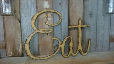This is a listing for a handmade Sign EAT. It is cut out of mdf board and then painted a yellow mustard color and finished with a special paint mix to give it an aged look. This is a nice accent piece to add to a shabby chic kitchen, dining room, or a rustic home. Great gift for anyone who loves the distressed look. Would also make a great photo prop!  PERSONALIZE!!!!!  Make any word you want!! Size Color Font  Size: 16 x 22 x 1/2 for the one in the photo! Other sizes available!  If you are…