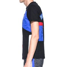 Product Description: -Protest view digital print patched tee -Extra soft black pique -Red, blue, white and yellow nylone patched panels  -Blue patched chest pocket w/ black zip -Round shape shell collar -Red nylon inside collar binding -100%Polyester -Made in Hong Kong