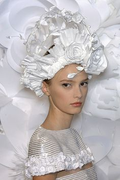 Detail shots from the Chanel Spring 2009 Haute Couture show depicting a selection of the intricate paper headdresses created by the Japanese hairdresser Katsuya Kamo. 65 headdresses were created out of two reams of standard printer paper by Komo and his tiny team of assistants for the show.
